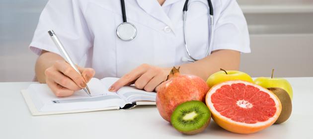 Female Dietician Writing Prescription